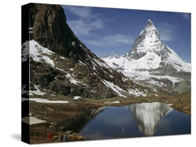 Tourists View the Matterhorn and its Reflection in Alpine Lake-Willard Culver-Stretched Canvas Print
