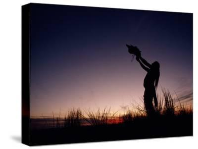 Native North American Holding an Artifact Up Towards the Sky-Chris Johns-Stretched Canvas Print