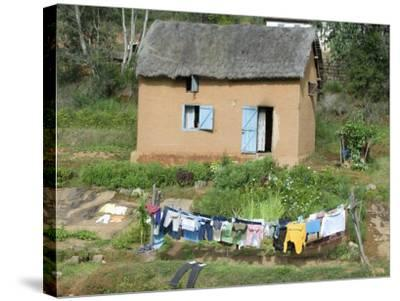 Clothes Drying on a Clothesline in Front of a House, Madagascar--Stretched Canvas Print