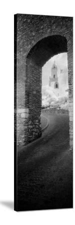 Church Viewed Through an Archway, Puerta Del Sol, Medina Sidonia, Cadiz, Andalusia, Spain--Stretched Canvas Print