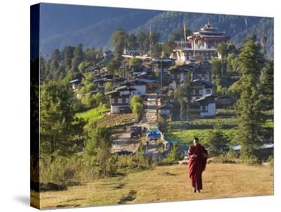 Monk Leaving Gangtey Dzong, and Village, Phobjikha Valley, Bhutan-Peter Adams-Stretched Canvas Print