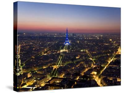 Eiffel Tower Lit in Blue, Paris at Night-Peter Adams-Stretched Canvas Print