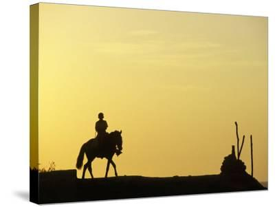 Boy on Horseback at the Beach Village of M! Ncora, in Northern Peru-Andrew Watson-Stretched Canvas Print