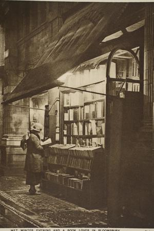 Examining a Book Outside a Second Hand Bookshop on a Wet Winter Evening, Bloomsbury--Stretched Canvas Print