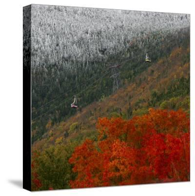 Tram Cars Take Tourists Up Cannon Mountain in New Hampshire as Snow Meets with Changing Leaves--Stretched Canvas Print