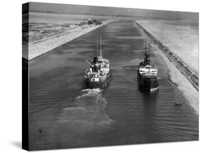 Ships in Suez Canal--Stretched Canvas Print