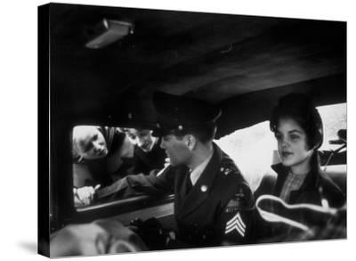 Elvis Presley Chatting with Fans Through Window, Sitting Beside Girlfriend Priscilla Beaulieu-James Whitmore-Stretched Canvas Print