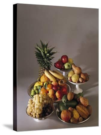 Close-Up of Fruits in Plates and Bowls--Stretched Canvas Print