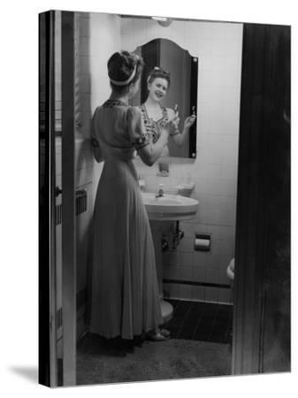 Young Woman Brushing Teeth in Bathroom-George Marks-Stretched Canvas Print