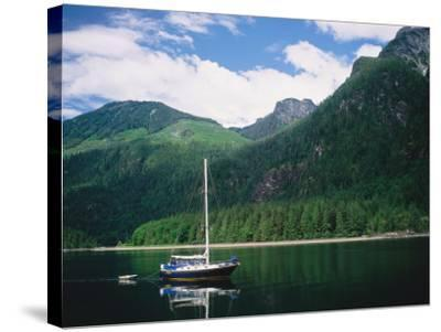 Detail of a Sailboat on Water Near Mountains-Jeff Foott-Stretched Canvas Print