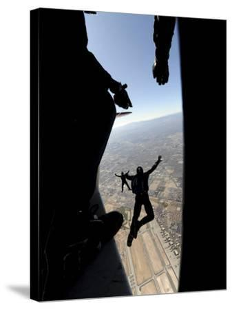 US Air Force Academy Parachute Team Jumps Out of an Aircraft over Nellis Air Force Base, Nevada--Stretched Canvas Print