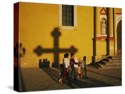 A Family Comes to Worship at the San Cristobal Church-Tomasz Tomaszewski-Stretched Canvas Print
