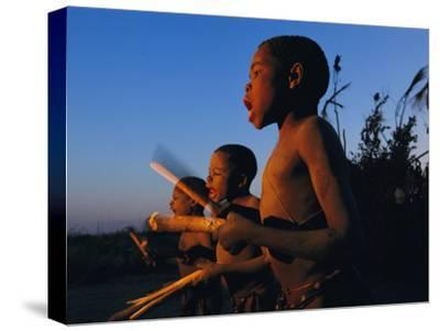 Newly Circumcised Boys from the Luvale Tribe Greet the Dawn-Chris Johns-Stretched Canvas Print