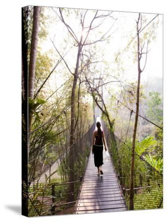 Woman Crossing Bridge Between Lobby and Accomodation Area at Four Seasons Tented Camp-Felix Hug-Stretched Canvas Print