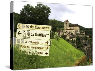 Tourist Signs Outside Village of St. Cirq Lapopie-Barbara Van Zanten-Stretched Canvas Print