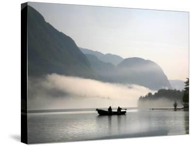 Two Fishermen in Boat on Lake Bohinj (Bohinjsko Jezero)-Ruth Eastham & Max Paoli-Stretched Canvas Print