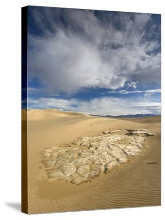 Huge Cumulus Cloud over Eroded and Cracked Clay Formation at Mesquite Flat Sand Dunes-Witold Skrypczak-Stretched Canvas Print