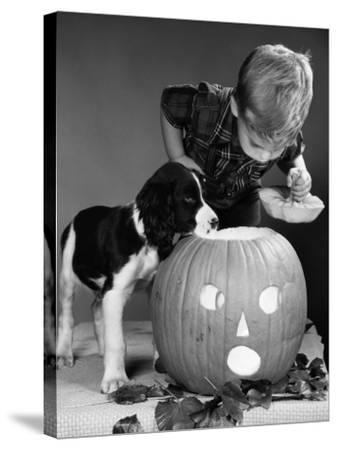 Boy and Jack-O-Lantern-H^ Armstrong Roberts-Stretched Canvas Print