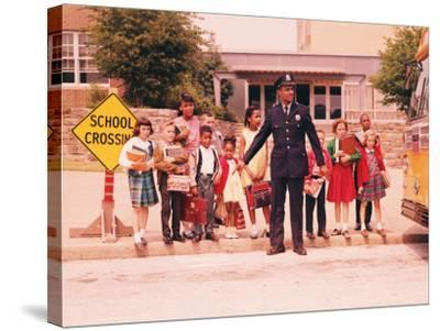 Group of Children at Curb in Front of School, Waiting For Signal From Policeman-H^ Armstrong Roberts-Stretched Canvas Print