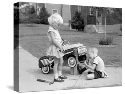 Children on Suburban Sidewalk, Boy Playing As Mechanic, Oiling Toy Pedal Car-H^ Armstrong Roberts-Stretched Canvas Print