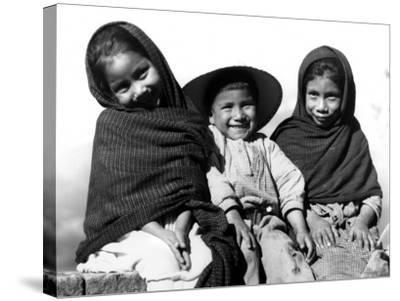 Portrait of Three Smiling Children, Sitting Together, Mexico-H^ Armstrong Roberts-Stretched Canvas Print