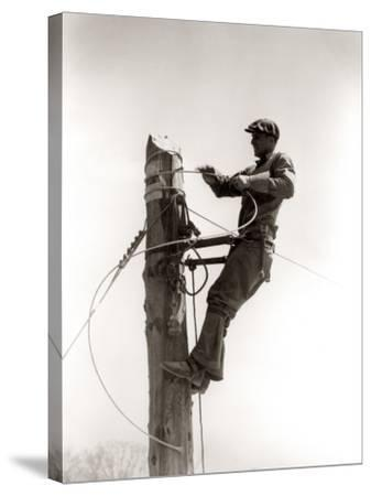 Working Atop Utility Pole-H^ Armstrong Roberts-Stretched Canvas Print