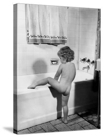 Baby Girl Climbing Into Bath Tub-H^ Armstrong Roberts-Stretched Canvas Print