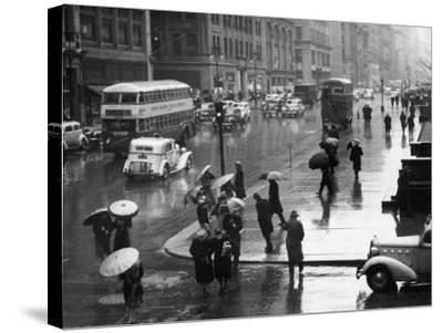 Traffic and People on Rainy City Street-George Marks-Stretched Canvas Print