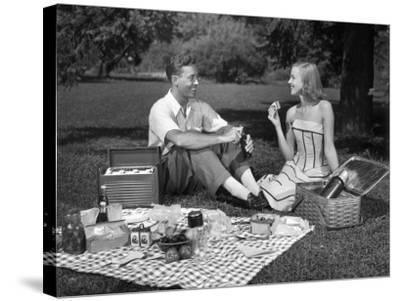 Couple Outdoors Having a Picnic-George Marks-Stretched Canvas Print