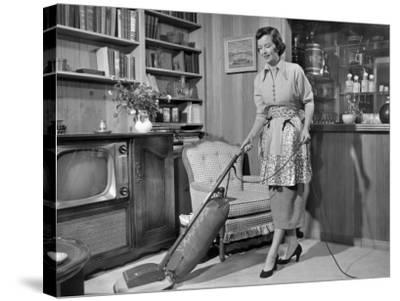 Apron Housewife Vacuuming Den-George Marks-Stretched Canvas Print