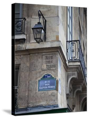 Street Sign and Building, Rive Guache, Paris, France-Jon Arnold-Stretched Canvas Print
