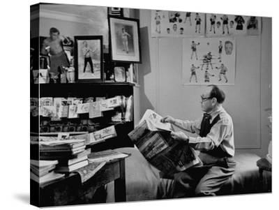 Charlie Goldman in His Room Reading the Newspaper--Stretched Canvas Print