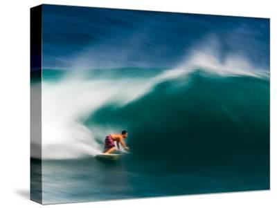 A Surfer Pulls into the Barrel on a Big Day at Uluwatu-Ben Horton-Stretched Canvas Print