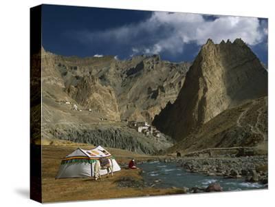 Trekker Writes in Diary Beside Tibetan Tent, Photoskar Village, Ladakh, Himalayas, Northwest India-Colin Monteath/Minden Pictures-Stretched Canvas Print