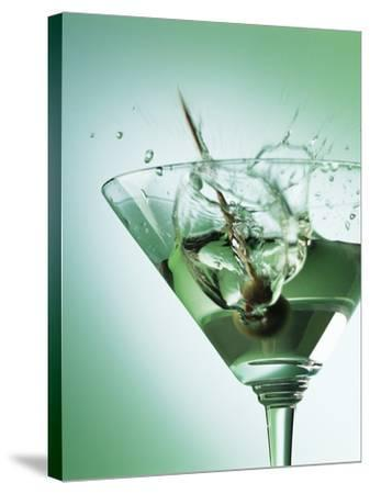 Martini with Olive Splash-Steve Lupton-Stretched Canvas Print