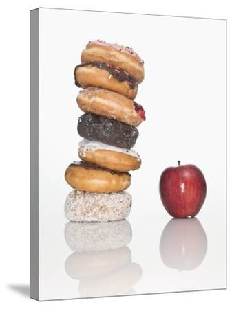 Stack of Donuts and One Apple--Stretched Canvas Print