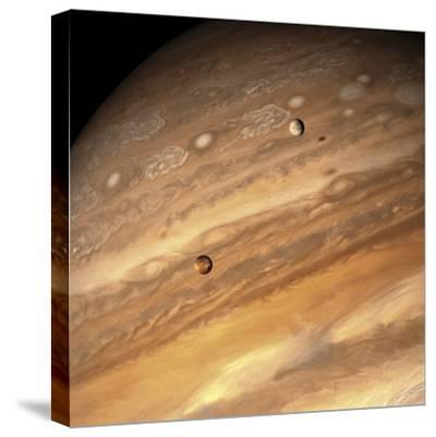 Io and Europa over Jupiter-Michael Benson-Stretched Canvas Print