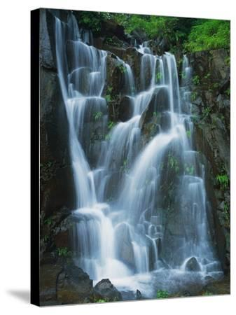 Waterfall Cascading over Rocks-Jagdish Agarwal-Stretched Canvas Print