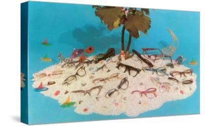 Eyeglasses on Simulated Desert Island--Stretched Canvas Print