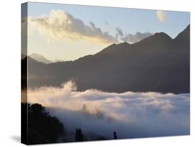 Hoang Lien Mountains and Morning Fog in Sapa Valley, Sapa, Vietnam, Indochina, Southeast Asia, Asia-Jochen Schlenker-Stretched Canvas Print