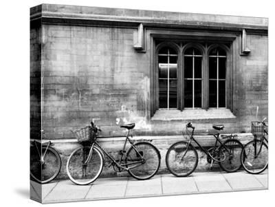 A Row of Bikes Leaning Against an Old School Building in Oxford, England-Keith Barraclough-Stretched Canvas Print