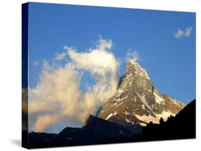 White Clouds and the Matterhorn, Zermatt,Valais, Swiss Alps, Switzerland, Europe-Hans Peter Merten-Stretched Canvas Print