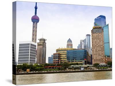 Pudong Skyline across the Huangpu River, Oriental Pearl Tower on Left, Shanghai, China, Asia-Amanda Hall-Stretched Canvas Print