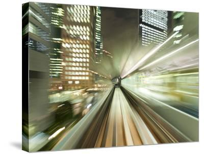 Asia, Japan, Honshu, Tokyo, Pov Blurred Motion of Tokyo Buildings from a Moving Train-Gavin Hellier-Stretched Canvas Print