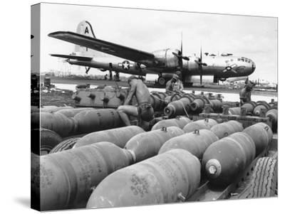 WWII Loading U.S. Bombers--Stretched Canvas Print
