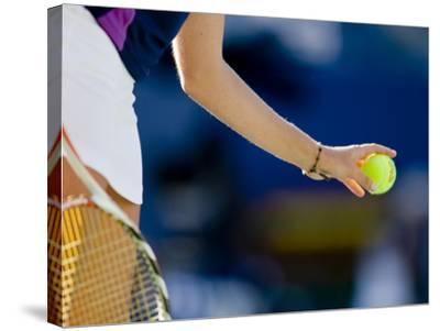 Detail of Woman Serving During Tennis Match--Stretched Canvas Print