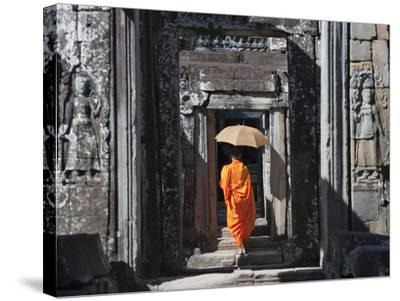 Monk with Buddhist Statues in Banteay Kdei, Cambodia-Keren Su-Stretched Canvas Print