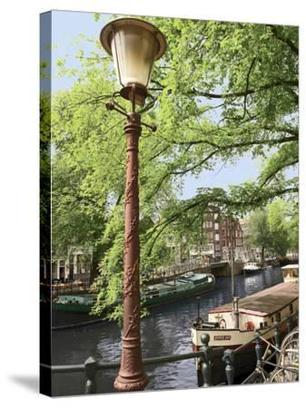 Old Gas Lamp Post and Bicycles on a Bridge over a Canal in Amsterdam, the Netherlands-Miva Stock-Stretched Canvas Print