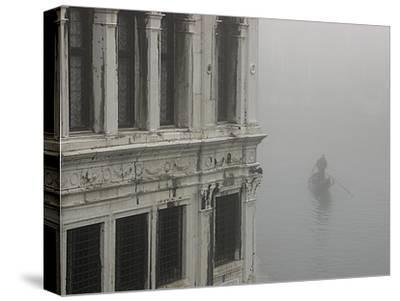 A Gondola Glides Through a Canal in Fog-Kike Calvo-Stretched Canvas Print