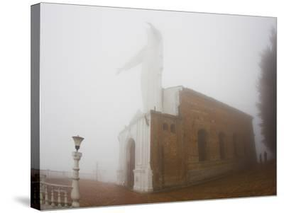 Thick Fog Engulfing the Santuario De Guadalupe Christ Statue-Mike Theiss-Stretched Canvas Print